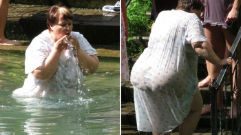 Fat woman plunges her big body into water