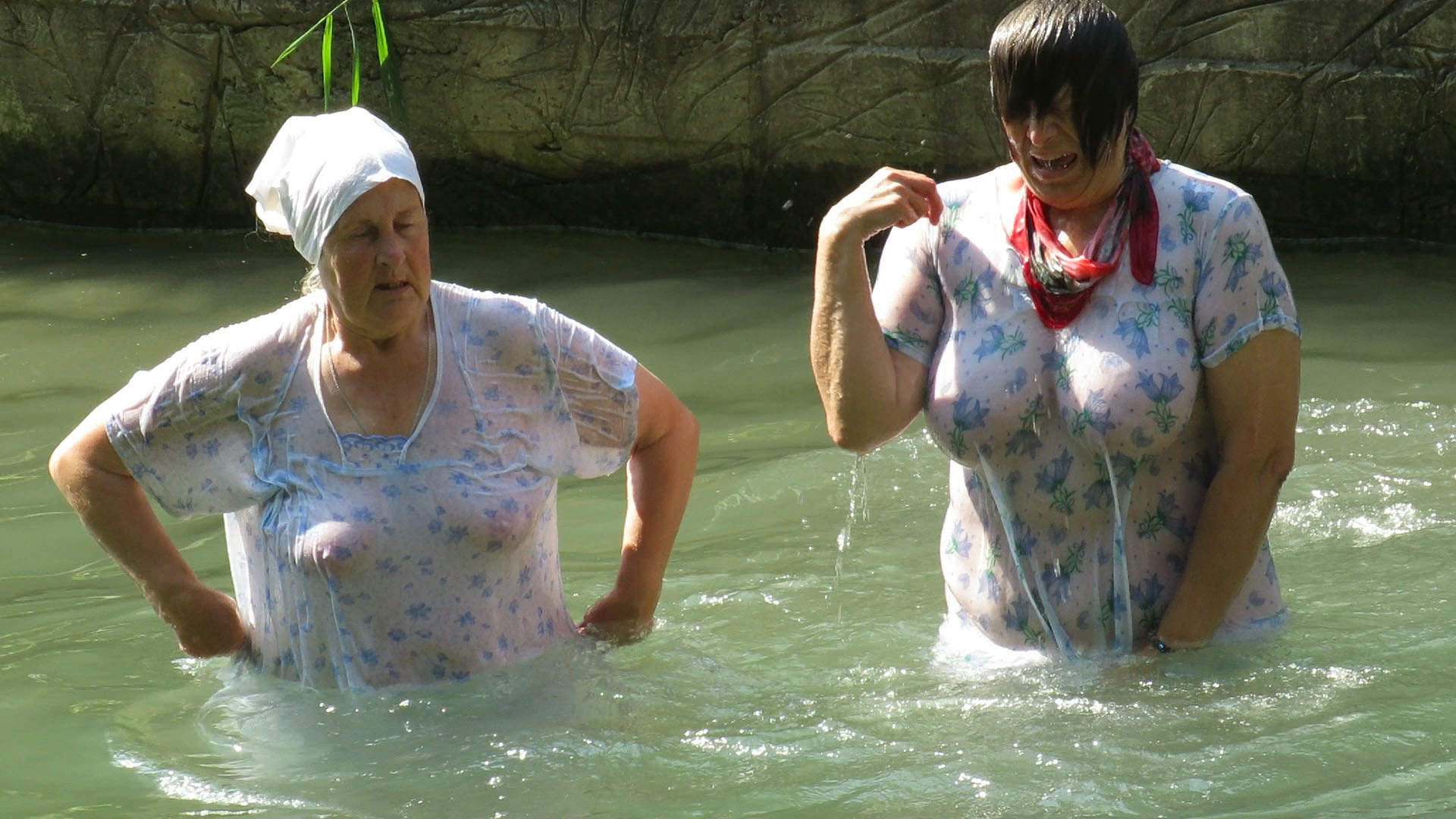 A couple of grannies plunging into cold water
