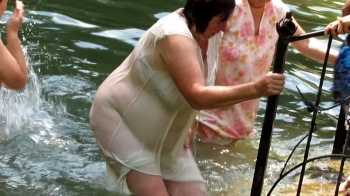 Fat woman punges in the water